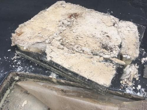 existing coverboard deterioration and wet insulation indicated previous roof leaks