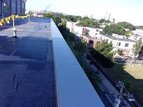 new zinc parapet coping cap installed on the Northwest Roof